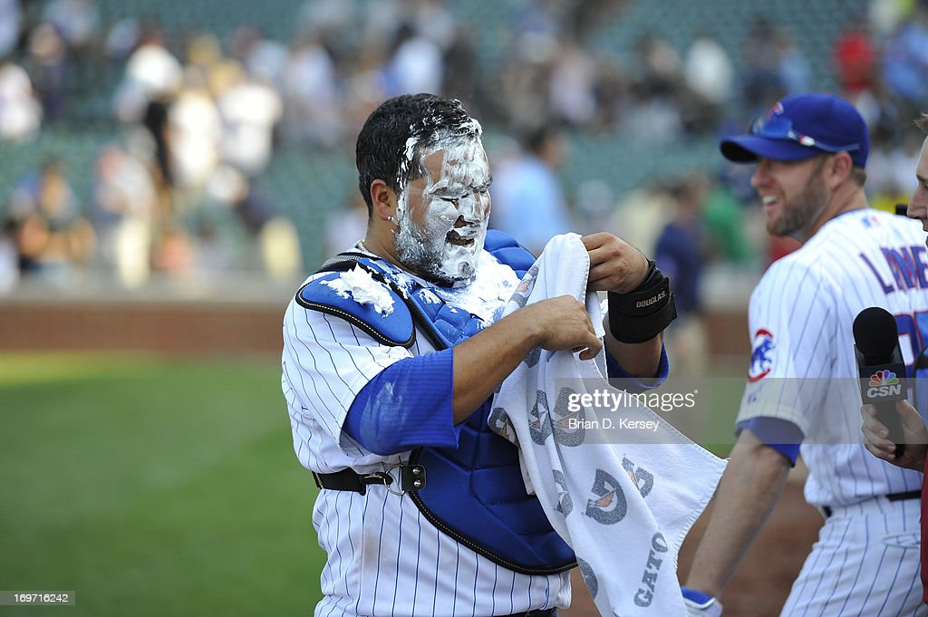 Dioner Navarro #30 of the Chicago Cubs wipes shaving cream from his face after receiving a shaving cream pie from teammates during a post game interview after the game against the Chicago White Sox at Wrigley Field on May 29, 2013 in Chicago, Illinois. Navarro hit three home runs in the game. The Cubs defeated the White Sox 9-3.