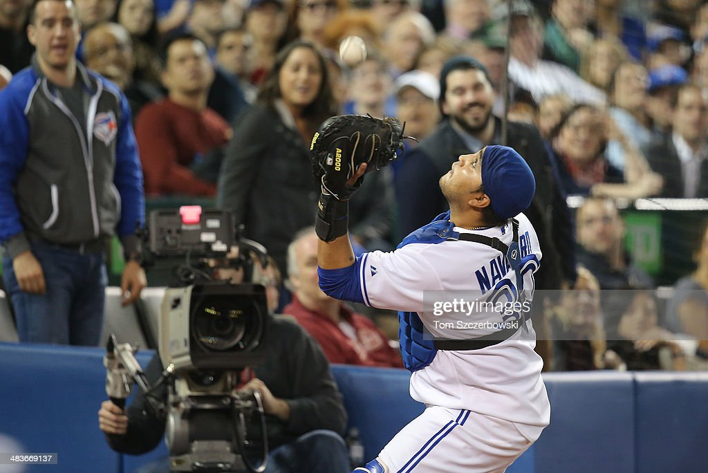 <a gi-track='captionPersonalityLinkClicked' href=/galleries/search?phrase=Dioner+Navarro&family=editorial&specificpeople=593062 ng-click='$event.stopPropagation()'>Dioner Navarro</a> #30 of the Toronto Blue Jays catches a foul pop up in the sixth inning during MLB game action against the Houston Astros on April 9, 2014 at Rogers Centre in Toronto, Ontario, Canada.