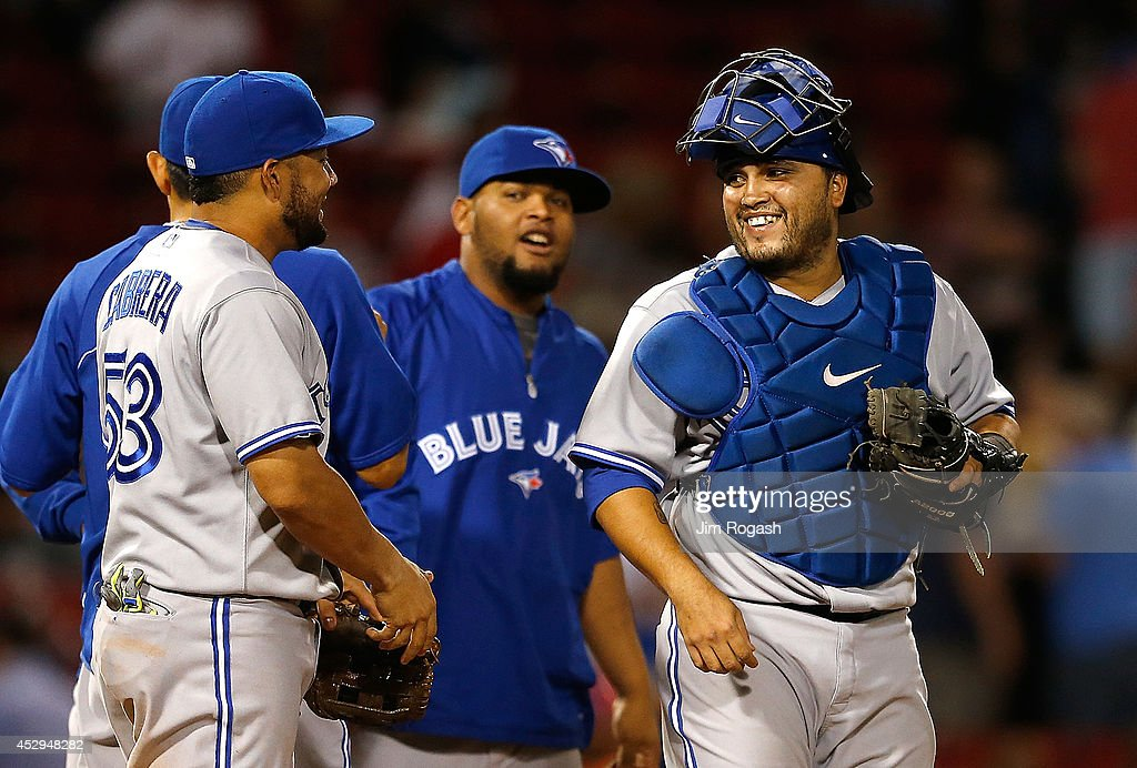 <a gi-track='captionPersonalityLinkClicked' href=/galleries/search?phrase=Dioner+Navarro&family=editorial&specificpeople=593062 ng-click='$event.stopPropagation()'>Dioner Navarro</a> #30 of the Toronto Blue Jays celebrates after defeating the Boston Red Sox, 6-1 at Fenway Park on July 30, 2014 in Boston, Massachusetts.