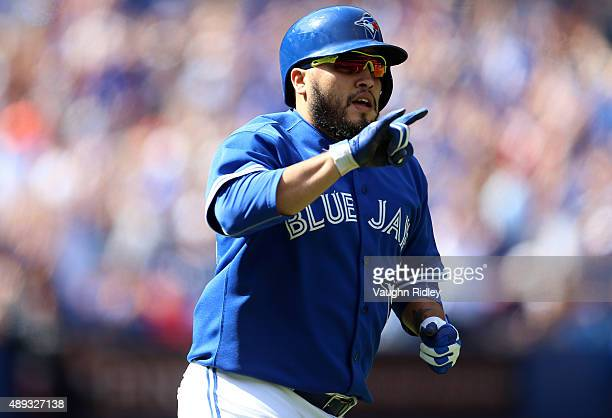 Dioner Navarro of the Toronto Blue Jays celebrates after hitting a home run in the second inning during a MLB game against the Boston Red Sox at...