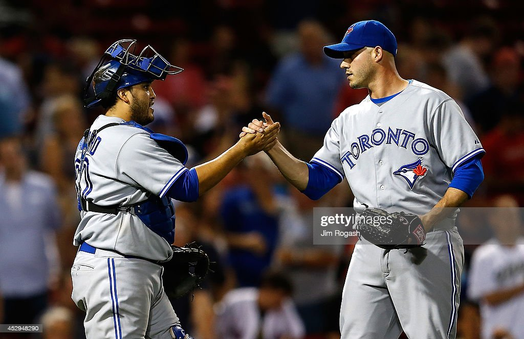 <a gi-track='captionPersonalityLinkClicked' href=/galleries/search?phrase=Dioner+Navarro&family=editorial&specificpeople=593062 ng-click='$event.stopPropagation()'>Dioner Navarro</a> #30 of the Toronto Blue Jays celebrates with <a gi-track='captionPersonalityLinkClicked' href=/galleries/search?phrase=Dustin+McGowan&family=editorial&specificpeople=809187 ng-click='$event.stopPropagation()'>Dustin McGowan</a> #29 after defeating the Boston Red Sox, 6-1 at Fenway Park on July 30, 2014 in Boston, Massachusetts.