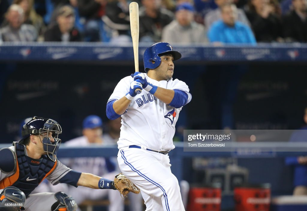 Dioner Navarro #30 of the Toronto Blue Jays hits a double in the fourth inning during MLB game action against the Houston Astros on April 9, 2014 at Rogers Centre in Toronto, Ontario, Canada.