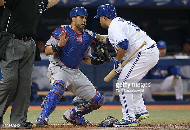 Dioner Navarro of the Toronto Blue Jays shows concern for fellow catcher Geovany Soto of the Texas Rangers after he hit Soto on his back swing in the...