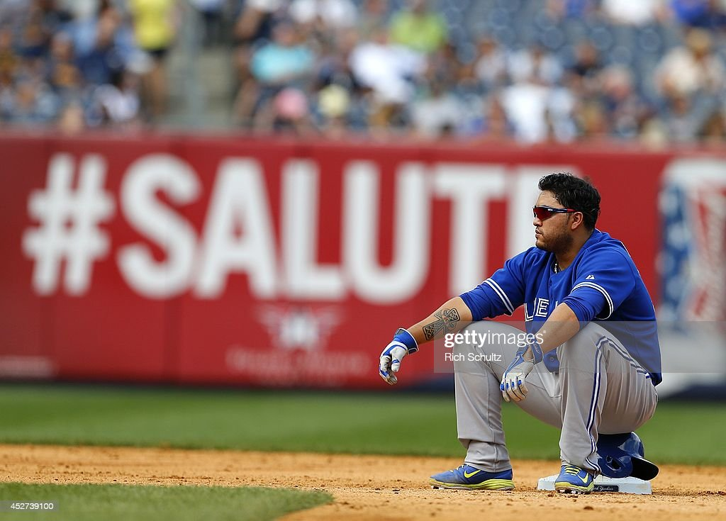 <a gi-track='captionPersonalityLinkClicked' href=/galleries/search?phrase=Dioner+Navarro&family=editorial&specificpeople=593062 ng-click='$event.stopPropagation()'>Dioner Navarro</a> #30 of the Toronto Blue Jays sits on second base during a pitching change in the ninth inning against the New York Yankees during an MLB baseball game at Yankee Stadium on July 26, 2014 in the Bronx borough of New York City. The Blue Jays defeated the Yankees 6-4.