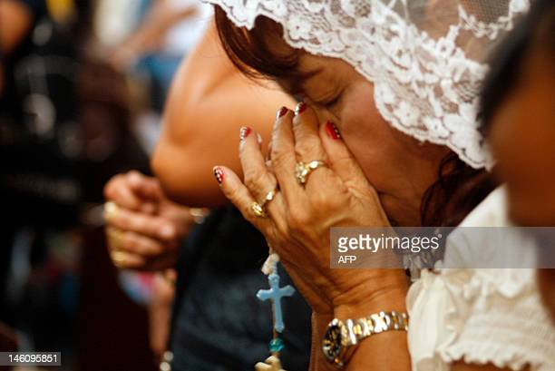 Dionisia Pacquiao mother of Philippine boxing icon Manny Pacquiao prays at a church in General Santos City in southern island of Mindanao on June 10...