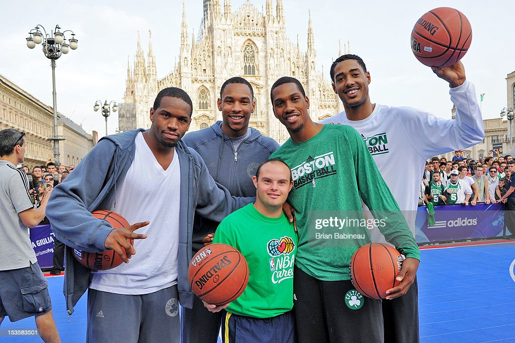 Dionte Christmas #12, Jared Sullinger #7, Kris Joseph #43 and Fab Melo #13 of the Boston Celtics pose for a photo as the Boston Celtics participate in NBA Cares program with the Special Olympics on October 6, 2012 at Piazza Duomo in Milan, Italy.