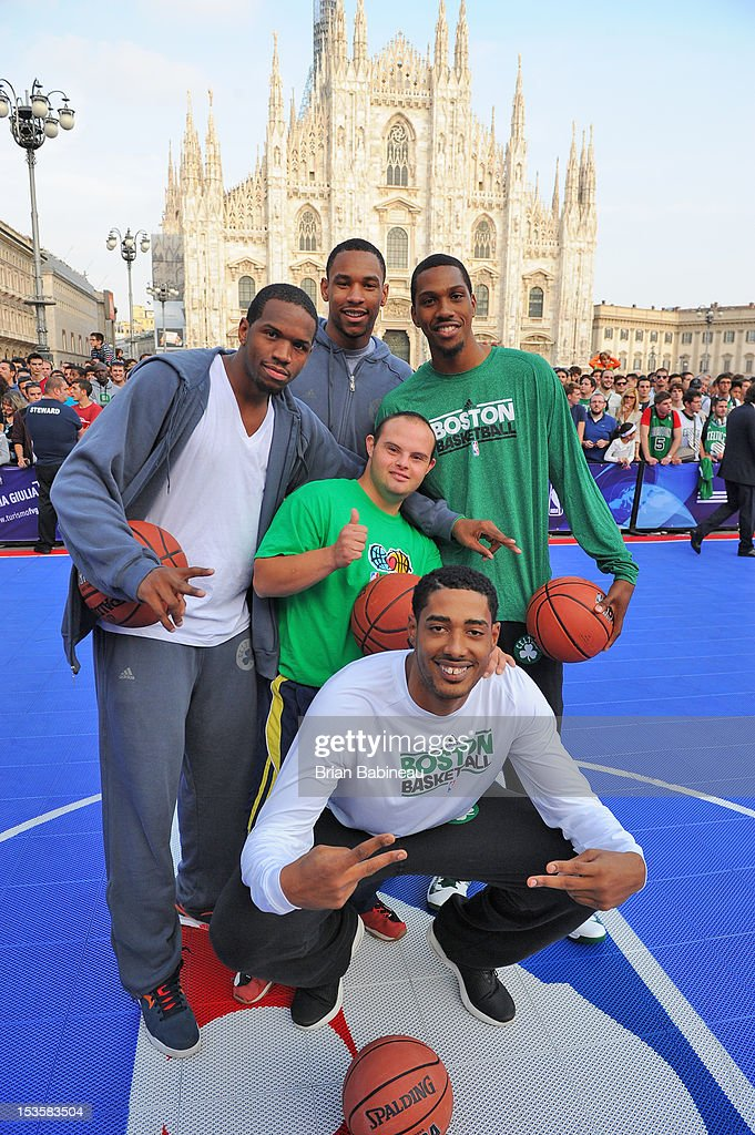 Dionte Christmas #12, Jared Sullinger #7, Kris Joseph #43 and Fab Melo #13 (Front) of the Boston Celtics pose for a photo as the Boston Celtics participate in NBA Cares program with the Special Olympics on October 6, 2012 at Piazza Duomo in Milan, Italy.