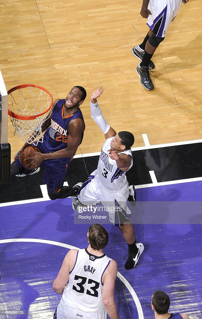 <a gi-track='captionPersonalityLinkClicked' href=/galleries/search?phrase=Dionte+Christmas&family=editorial&specificpeople=4091611 ng-click='$event.stopPropagation()'>Dionte Christmas</a> #25 of the Phoenix Suns shoots against Ray McCallum #3 of the Sacramento Kings on April16, 2014 at Sleep Train Arena in Sacramento, California.