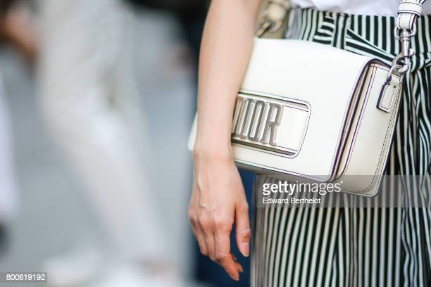 Dior bag is seen outside the Hermes show during Paris Fashion Week Menswear Spring/Summer 2018 on June 24 2017 in Paris France