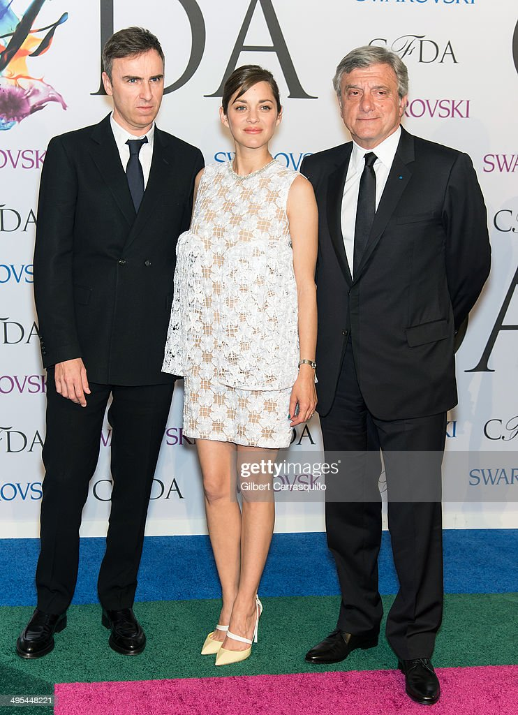 Dior CEO Sidney Toledano, actress Marion Cotillard and International award recipient Raf Simons for Dior attend the 2014 CFDA fashion awards at Alice Tully Hall, Lincoln Center on June 2, 2014 in New York City.