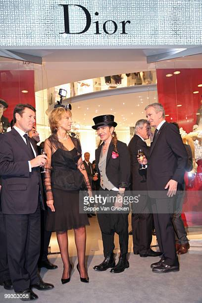 Dior designer John Galliano LVMH chairman Bernard Arnault and Helene Arnault bring a toast to the opening of the new Dior shop in Shanghai on May 14...