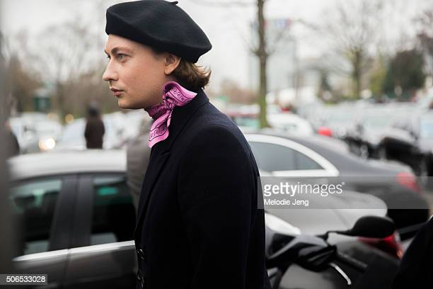 Dior Homme showgoer wears a black beret and pink handkerchief/bandana around their neck on January 23 2016 in Paris France