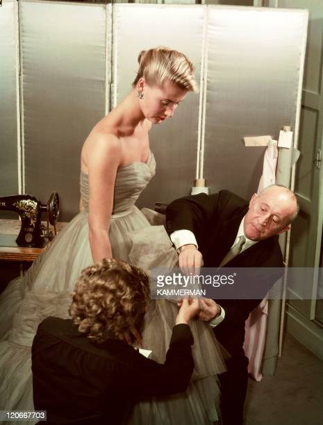 Dior in France in the 1950s Fitting and editing to a dress under the auspices of Christian Dior