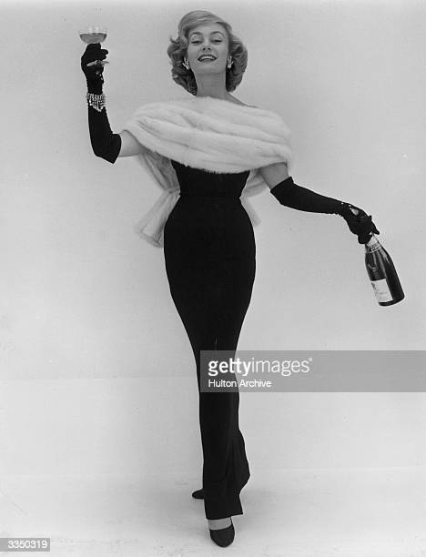 Dior model Jean Dawnay posing with champagne and furs is held by the Victoria Albert Museum to create the definitive model shot