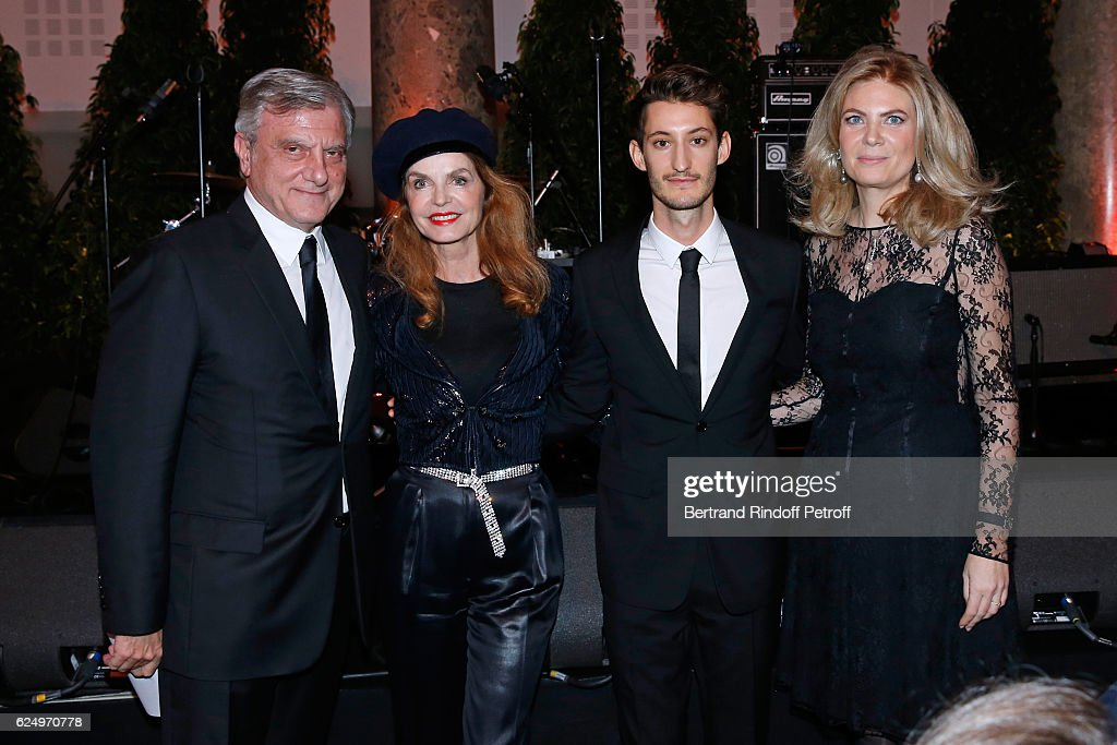 CEO Dior Sidney Toledano, actress Cyrielle Clair, actor Pierre Niney and President of Care France, Arielle de Rothschild attend the 'Diner des amis de Care' for the 70th anniversary of the Association. Held at Espace Cambon on November 21, 2016 in Paris, France.