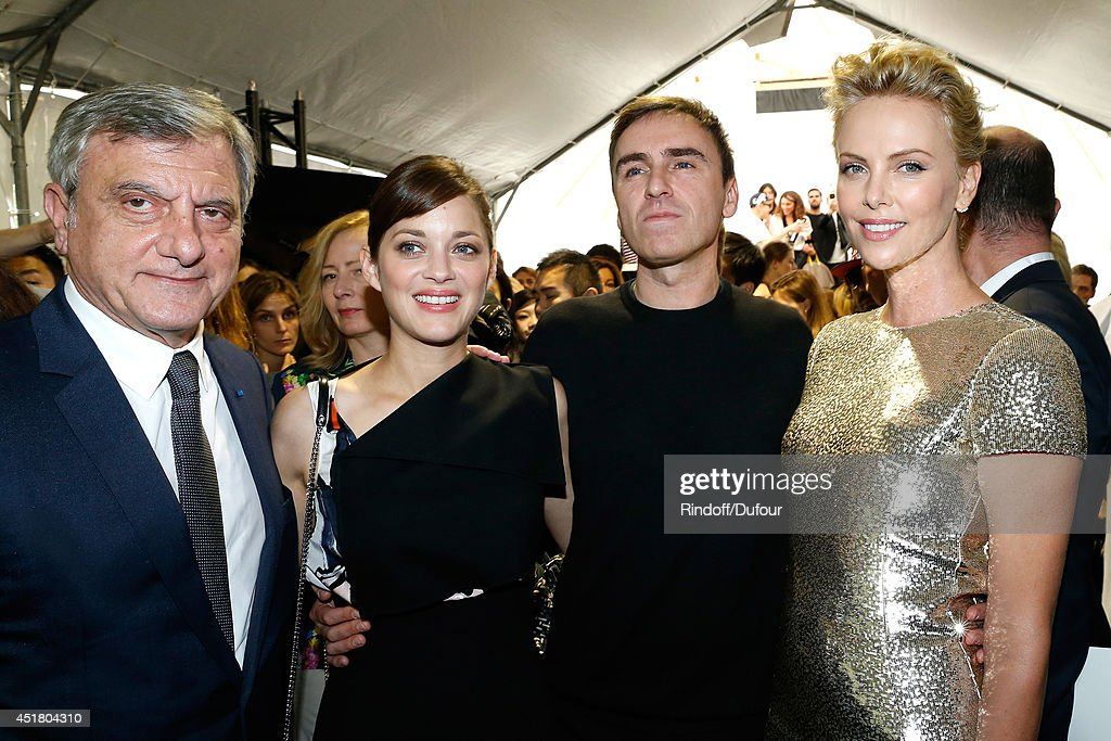 CEO Dior Sidney Toledano, actress Marion Cotillard, Fashion designer Raf Simons and Actress Charlize Theron pose backstage after the Christian Dior show as part of Paris Fashion Week - Haute Couture Fall/Winter 2014-2015. Held at Musee Rodin on July 7, 2014 in Paris, France.