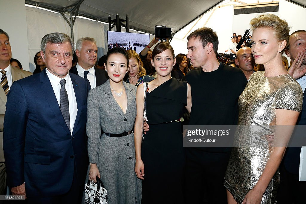 CEO Dior Sidney Toledano, actress Zhang Ziyi, actress Marion Cotillard, Fashion designer Raf Simons and Actress Charlize Theron pose backstage after the Christian Dior show as part of Paris Fashion Week - Haute Couture Fall/Winter 2014-2015. Held at Musee Rodin on July 7, 2014 in Paris, France.
