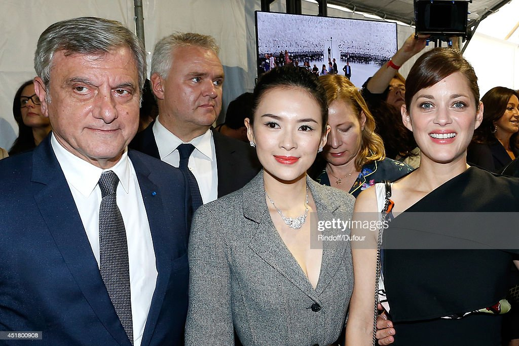 CEO Dior Sidney Toledano, actress Zhang Ziyi and actress Marion Cotillard pose backstage after the Christian Dior show as part of Paris Fashion Week - Haute Couture Fall/Winter 2014-2015. Held at Musee Rodin on July 7, 2014 in Paris, France.
