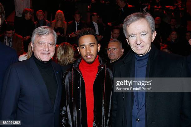 CEO Dior Sidney Toledano Formula One driver Lewis Hamilton and Owner of LVMH Luxury Group Bernard Arnault the Dior Homme Menswear Fall/Winter...
