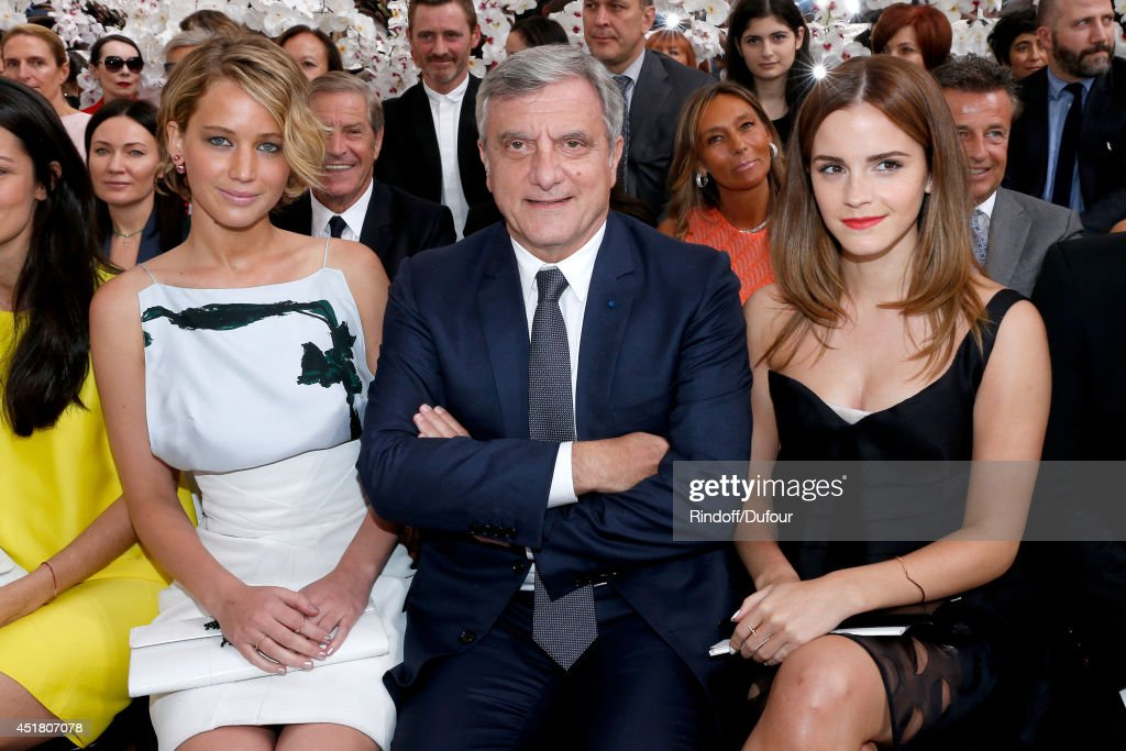 Dior <a gi-track='captionPersonalityLinkClicked' href=/galleries/search?phrase=Sidney+Toledano&family=editorial&specificpeople=758670 ng-click='$event.stopPropagation()'>Sidney Toledano</a> sitting between actresss <a gi-track='captionPersonalityLinkClicked' href=/galleries/search?phrase=Jennifer+Lawrence&family=editorial&specificpeople=1596040 ng-click='$event.stopPropagation()'>Jennifer Lawrence</a> (L) and <a gi-track='captionPersonalityLinkClicked' href=/galleries/search?phrase=Emma+Watson&family=editorial&specificpeople=171373 ng-click='$event.stopPropagation()'>Emma Watson</a> (R) attend the Christian Dior show as part of Paris Fashion Week - Haute Couture Fall/Winter 2014-2015. Held at Musee Rodin on July 7, 2014 in Paris, France.