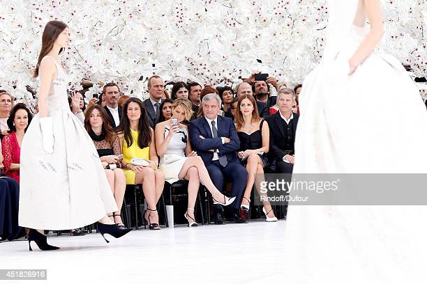Dior Sidney Toledano sitting between actresss Jennifer Lawrence and Emma Watson attend the Christian Dior show as part of Paris Fashion Week Haute...