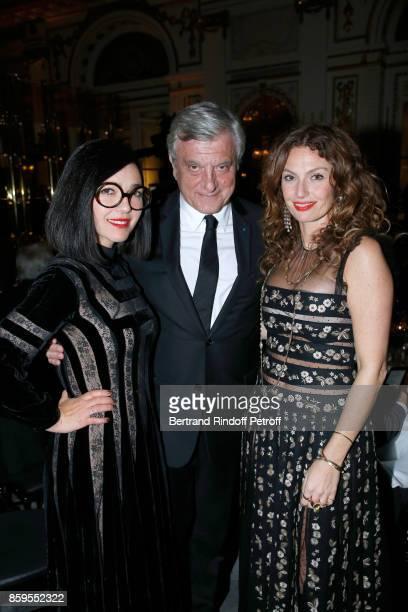Dior Sidney Toledano standing between Members of Musical Group 'Brigitte' Aurelie Saada and Sylvie Hoarau attend the 'Diner des Amis de Care' at...