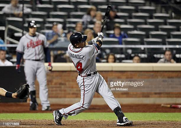 Diory Hernandez of the Atlanta Braves hits a ninth inning pinch hit threerun home run against the New York Mets on June 5 2011 at Citi Field in the...