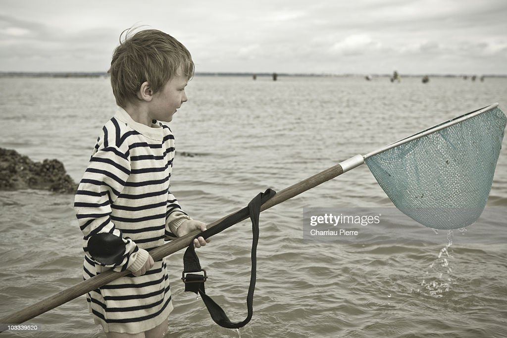 Dip net fishing, grandfather and his grandchildren : Stock Photo