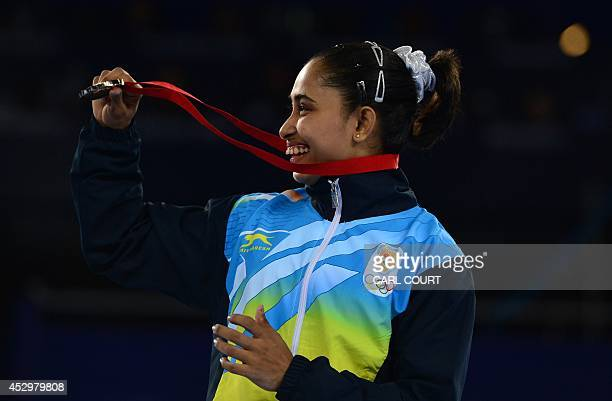 Dipa Karmakar of India shows off her bronze medal after performing in the womens vault final of the Artistic Gymnastics event during the 2014...