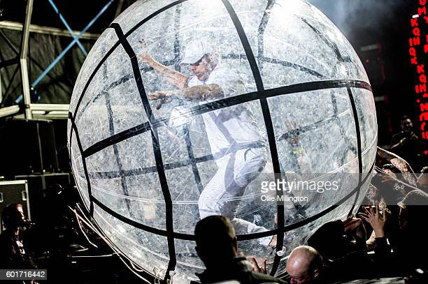 Diplo of Major Lazer zorbs accross the crowd as Major Lazer perform onstage headlining The Main stage at the end of Day 2 of Bestival 2016 at Robin...