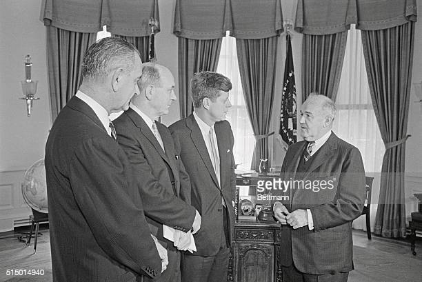 Diplomat Arthur H Dean meets with President John F Kennedy Secretary of State Dean Rusk and Vice President Lyndon Johnson before leaving to become...