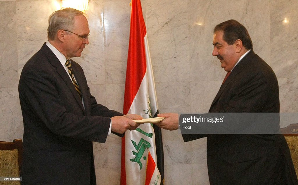 US diplomat Christopher Hill presents his credentials to Iraqi Foreign Minister Hoshyar Zebari at the Foreign Ministry in Baghdad on April 24 2009 in...