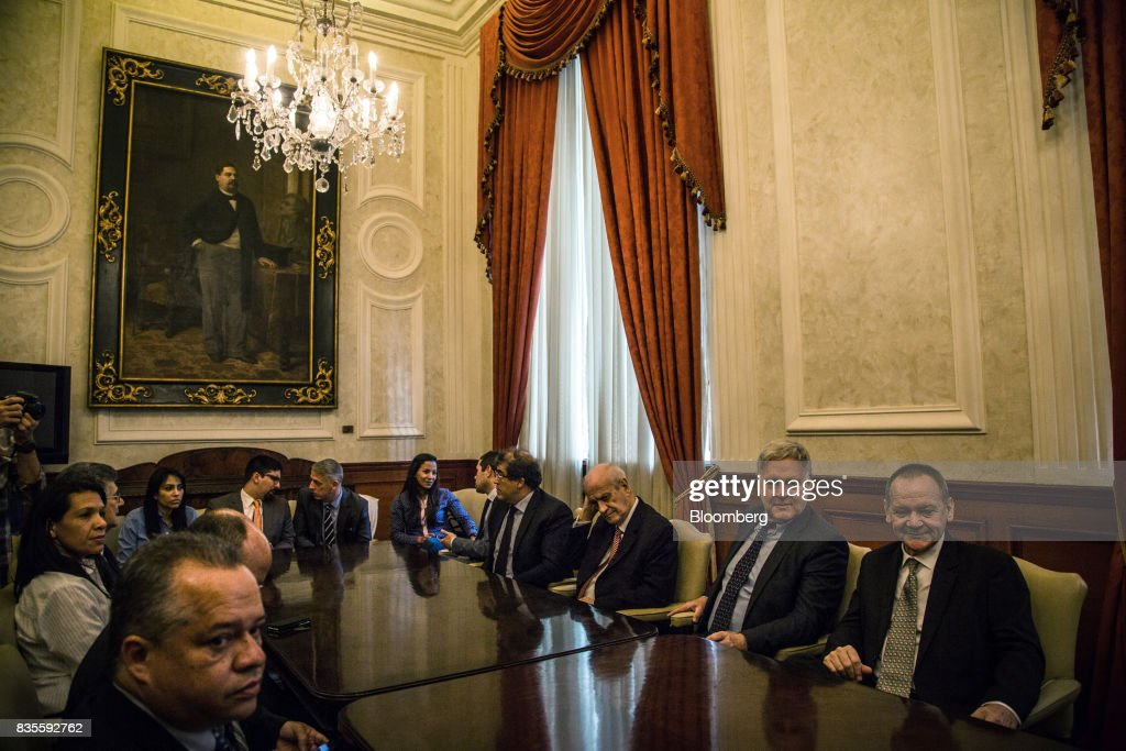 Diplomats and lawmakers sit in a conference room after a special session of the National Assembly of Caracas, Venezuela, on Saturday, Aug. 19, 2017. Venezuela's new legislative super body took over the functions of the country's only remaining opposition-run institution -- the National Assembly -- by approving a decree that empowers it to pass laws on a range of issues. Photographer: Wil Riera/Bloomberg via Getty Images