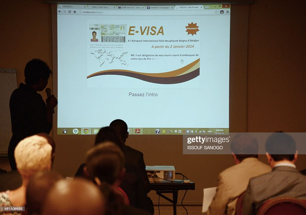 Diplomats and travel agents attend a conference for the presentation of Ivory Coast's new biometric visa on January 8, 2014 in Abidjan. The visa to enter the Ivory Coast will now be issued on arrival at the airport, facilitating access to the West Africa country.