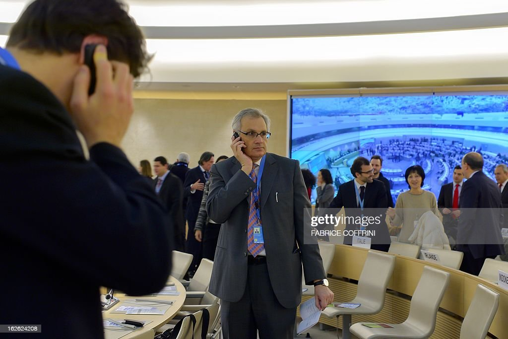Diplomats use their mobile phone at the opening of the 22nd session of the UN Human Rights Council on February 25, 2013 in Geneva. The Council kicks off with widespread abuses in North Korea and Mali the top items on the agenda, along with the crisis in Syria.