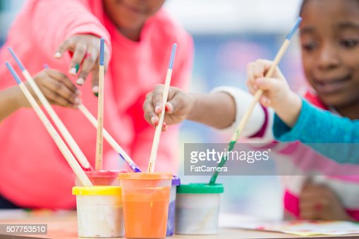 Dipping Paint Brushes In Paint Stock Photo Getty Images