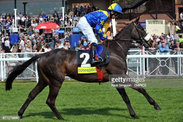 Dirar ridden by jockey Wayne Lordan going to post prior to The totesportcom Chester Cup race