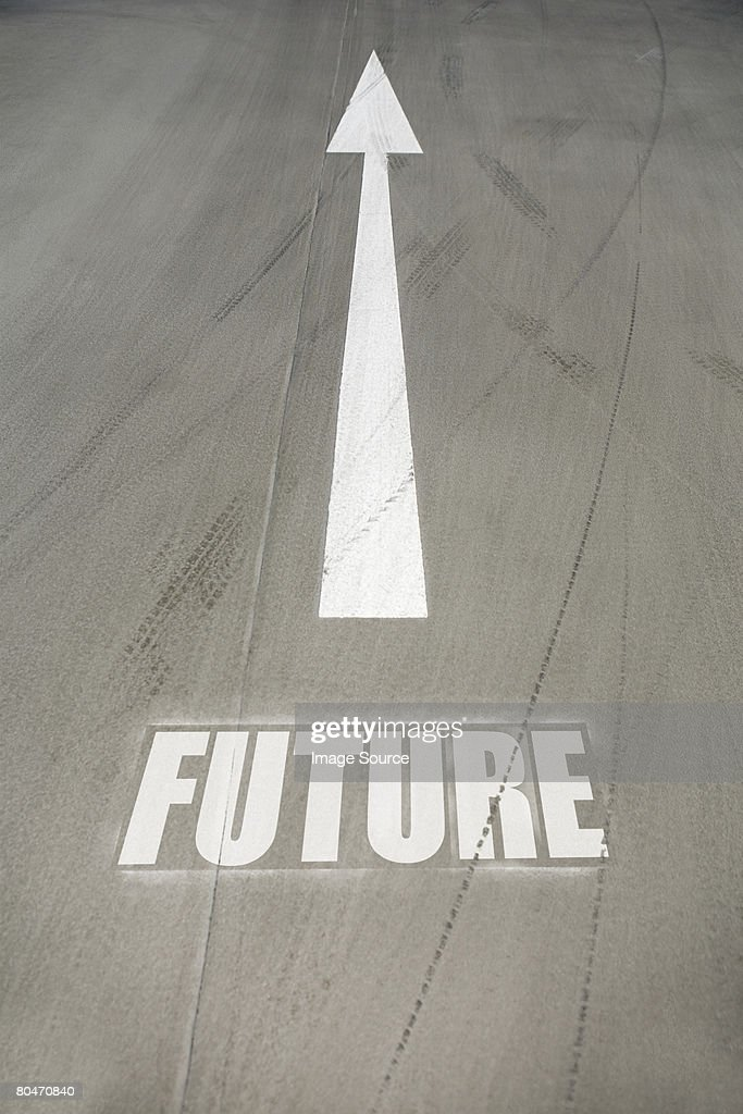 Direction arrow on the road : Stock Photo