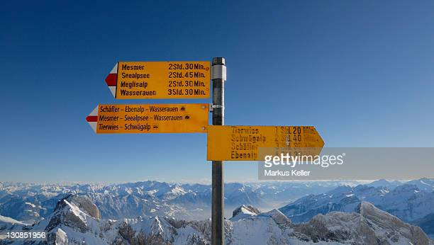 A direction sign on the top of saentis - Switzerland, Europe.