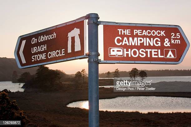 direction signs at the cloonee lakes at sunset