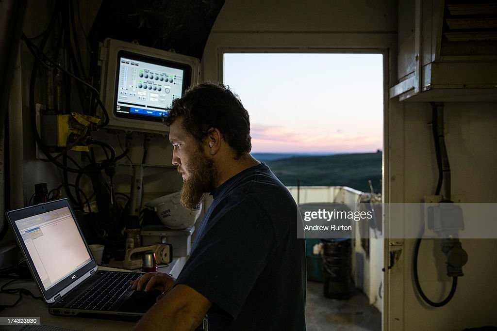 A directional driller reviews computer monitors while drilling for oil in the Bakken shale formation on July 23, 2013 outside Watford City, North Dakota. North Dakota is been experiencing an oil boom in recent years, due in part to new drilling techniques including hydraulic fracturing and horizontal drilling. In April 2013, The United States Geological Survey released a new study estimating the Bakken formation and surrounding oil fields could yield up to 7.4 billion barrels of oil, doubling their estimate of 2008, which was stated at 3.65 billion barrels of oil. Workers for Raven Drilling work 12-hour days, working 14 days straight, and then having 14 days off. They stay at a camp nearby.