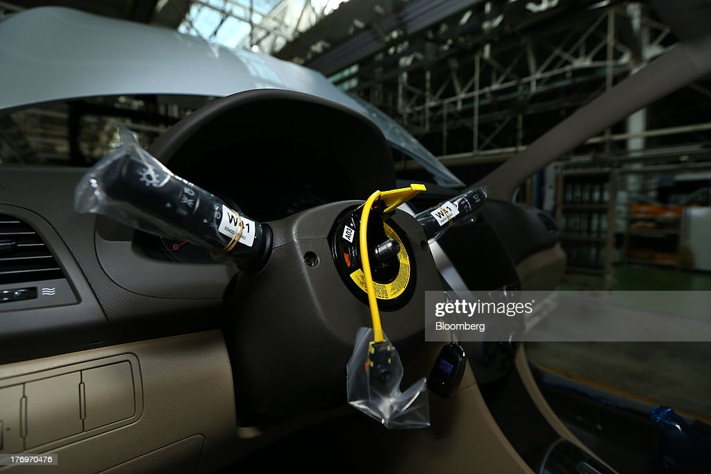 Directional indicators sit on the steering column of a vehicle on the halted assembly line at the Hyundai Motor Co. plant during a strike by the company's labor union in Ulsan, South Korea, on Tuesday, Aug. 20, 2013. Union members at Hyundai Motor, South Korea's largest automaker, staged a partial strike today that will continue tomorrow as they demand higher wages amid increasing competition with Japanese carmakers. Photographer: SeongJoon Cho/Bloomberg via Getty Images