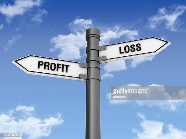 Segno di direzione con perdita di profitti parole