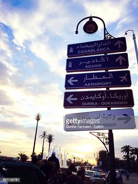 Directional Signs Against Sky