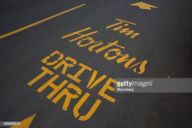 Directions for a drivethru covers the pavement outside of a Tim Hortons Inc restaurant in Oakville Ontario Canada on Monday Sept 16 2013 Tim Hortons...