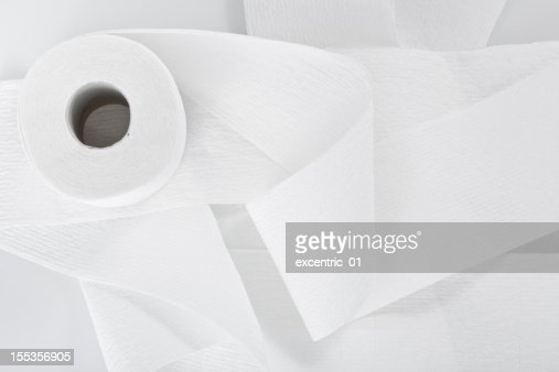 Directly above a roll of toilet paper isolated on white