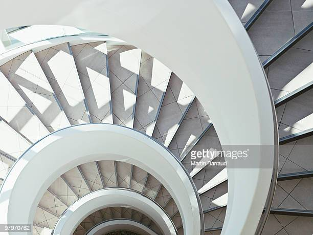 Directly above modern, spiral staircase