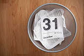 Directly above of wastepaper basket with calendar card