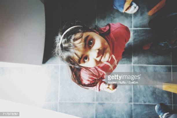 Directly Above Portrait Of Girl Standing At Home
