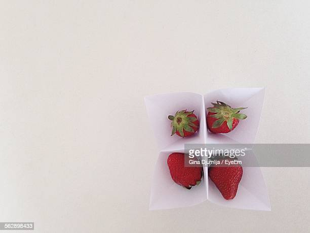 Directly Above Shot Fortune Teller Paper With Strawberries On Table